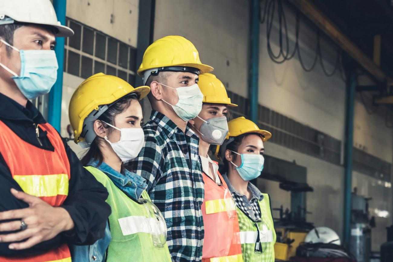 factory workers wearing masks
