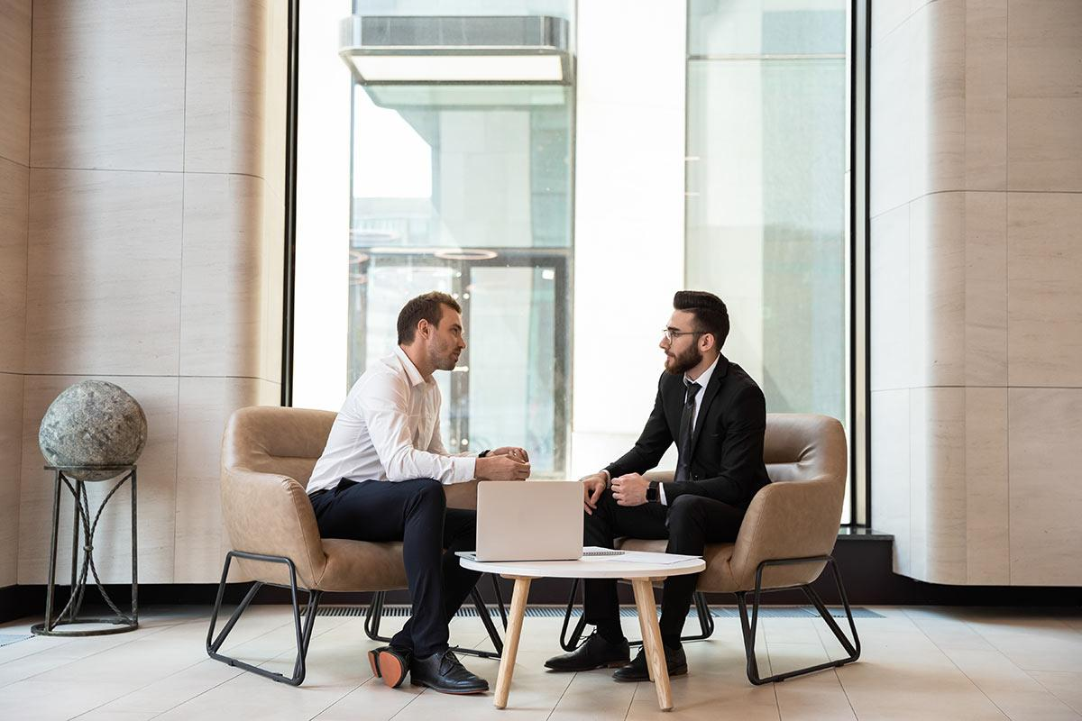 two businessmen sitting at a table