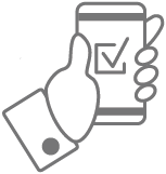 Hand holding a mobile device showing a checkmark